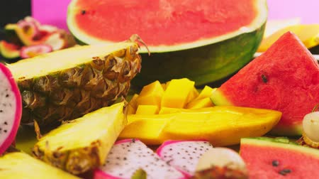 passievrucht : Mixed tropical fruits, closeup. fresh fruit sliced. background.