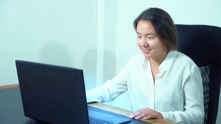 touch : cute asian girl use laptop at table in office
