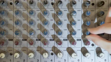mixer : close-up. Hand Turns the pan knob on the sound mixer Stock Footage