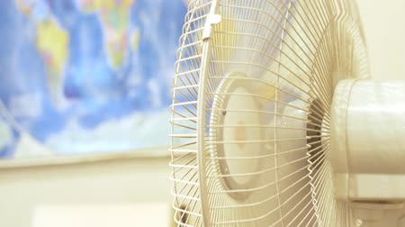 conditioner : close-up. Fan conditioner rotating. on the background of a blurred map of the world hanging on the wall Stock Footage