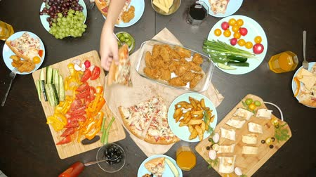 pita : concept of family leisure and eating. top view of people at a large table eating together Stock Footage