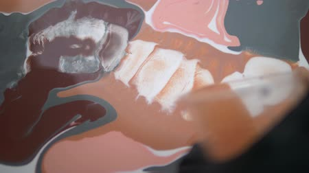 ebruli : a drop of alcohol drops from a pipette onto a canvas with acrylic paint. the interaction of alcohol and water-based acrylics. Liquid marble texture luxury. Fluid art. Stok Video