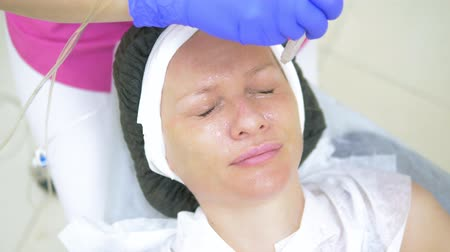 mezoterapia : cosmetology concept, face care. woman face during the procedure of jet peeling, facial