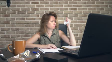doubt : creative crisis concept, blocking ideas. annoyed woman sitting at a laptop in a modern loft. Stock Footage