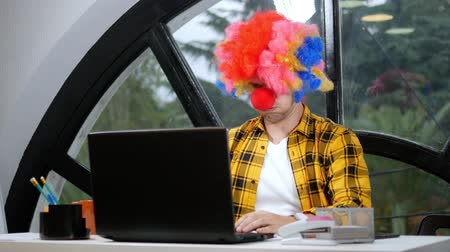 fool : allegory concept, office worker. Clown manager in the office