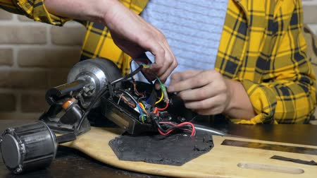 配線 : mechanic repairing an electric motor of an electric skate. bearing close up