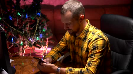 his : Happy New Year and Merry Christmas. close-up. male hands texting sms message on smartphone Stock Footage
