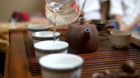 Traditional chinese tea ceremony. the process of heating dishes with boiling water. close-up