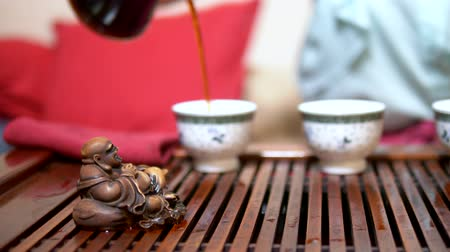 tea ceremony : Traditional chinese tea ceremony. close-up. someone pours tea into cups