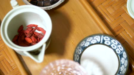 Traditional chinese tea ceremony. Goji berry tea and dessert. Stock mozgókép