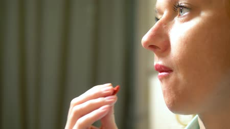 nutricional : mouth close-up. Woman eating a goji berry snack. Healthy eating and lifestyle. diet. Vídeos