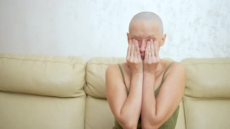 유방 : depression sad bald woman with cancer after chemotherapy. sitting on the couch crying.