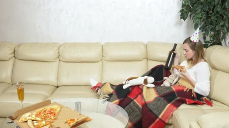 peluche : lonely woman celebrates in the company of soft toys, on the couch, drinks wine
