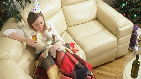 peluş : lonely woman celebrates in the company of soft toys, on the couch, drinks wine