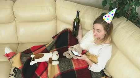 blahopřání : the girl celebrates the holiday at home alone. drinking, and use the phone