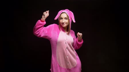 pizsama : girl in pink pajamas kigurumi in VR glasses on a black background. pajama party