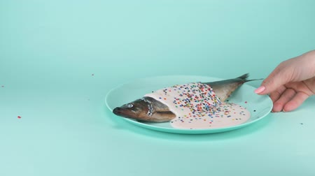 экзотичность : fashion food. fish herring with rhinestone, pink sauce and a colorful confetti
