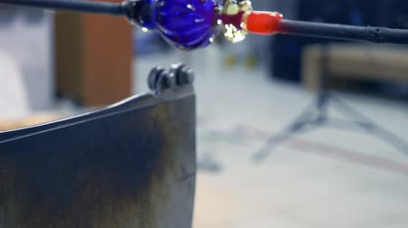 shaping : glassblower. craft manufacturing of glass products