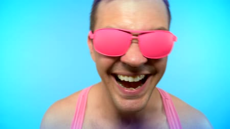 punker : Loop video. GIF art design. Stylish freak in pink glasses shouts wow.