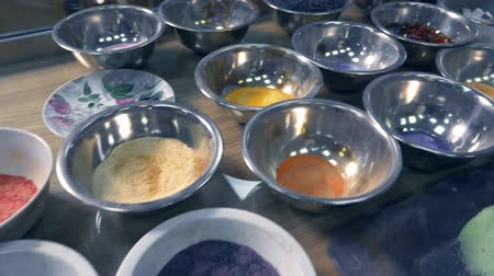 kuvars : glassblower. colored quartz sand in glass workshop