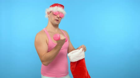 acteur : Playful handsome man in fashionable pink glasses, Merry Christmas and New Year