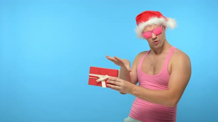 szörnyszülött : Playful handsome man in fashionable pink glasses, Merry Christmas and New Year