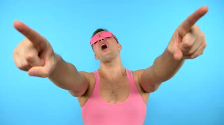 урод : loop video. art GIF design. Stylish freak guy in pink glasses. blue background