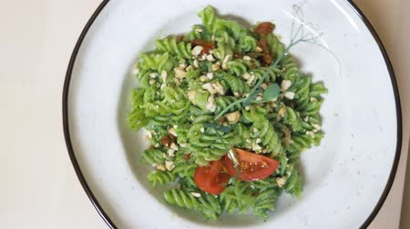kesudió : fashionable design food. vegetarian pasta with green sauce and cashew nuts