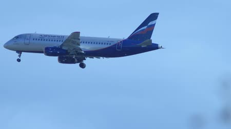 sochi : Aeroflot airplane in a clear blue sky is landing. January 16, 2020. Sochi Russia Stock Footage