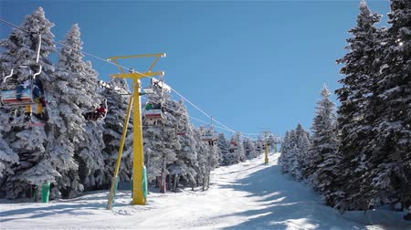 chair lift : Ski lift.Ski lift moves up to the mountain in the sunny day.