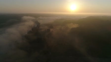 Drone footage above the river in fog