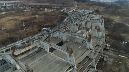 Ruins of a large football stadium construction from bird view. Close up