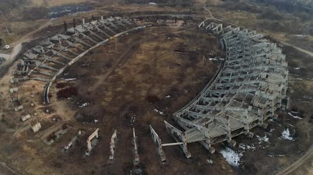 Ruins of a large football stadium construction. Aerial Drone footage