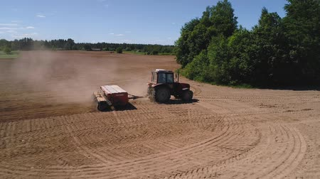 seeder : Close up drone shot of a tractor seeding a field