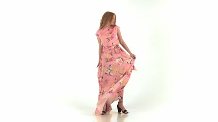 Fashion model in flying pink dress. Slow motion