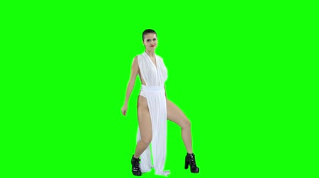 booty : A girl in a white dress is dancing, on a green screen