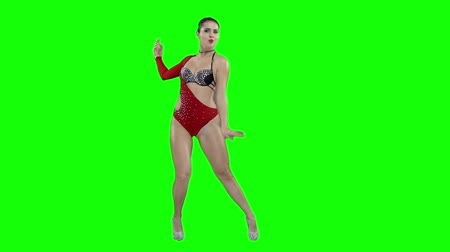 heyecan verici : A girl in a red swimsuit is dancing, on a green screen