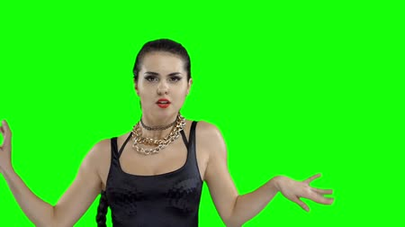 booty : Girl in a girl in a black swimsuit with a ball in the shape of a heart, on a green screen