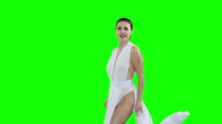 booty : A girl in a white dress is dancing, on a green screen slow motion