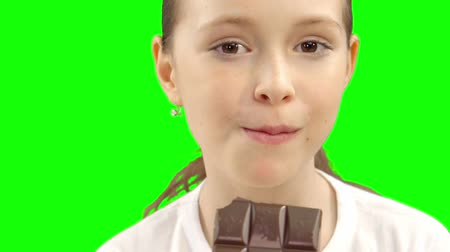 caloric : Little girl eating chocolate. Stock Footage