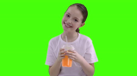pigtail : Nice girl drinking through a straw drink. Green screen