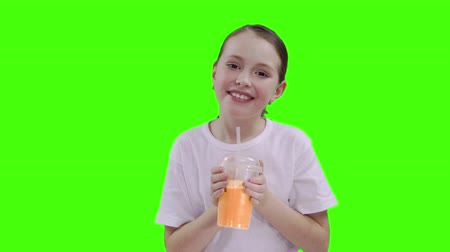 braid hairs : Nice girl drinking through a straw drink. Green screen