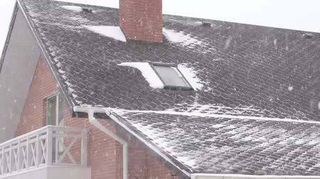 coming home : Day, snow blizzard, roof of the house Slow motion
