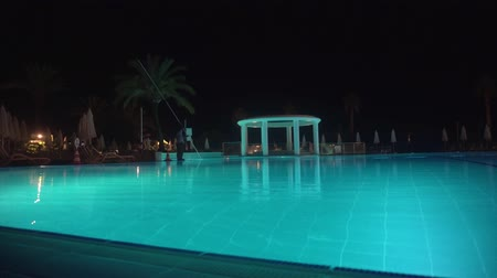 The swimming pool at night without people.