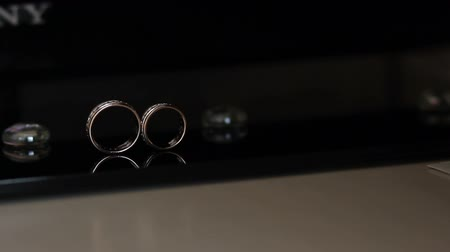 ring : wedding rings roll together Stock Footage