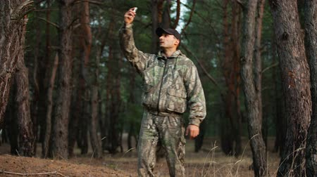 perdido : Man in forest try to catch signal of mobile phone