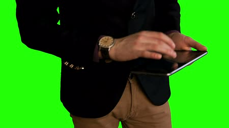seo : man hands work with tablet green screen 2