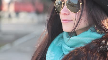bravery : Beautiful girl in glasses and a hat on the street Stock Footage