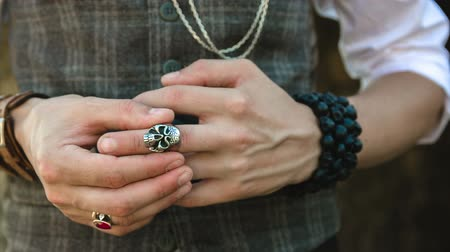 kafatası : Hand with a ring in the form of a skull holding a handgun, close up Stok Video