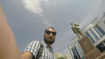totalitarianism : tourist against of monument to Lenin